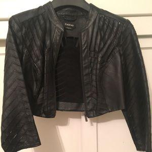 Bebe cropped laser cut leather jacket
